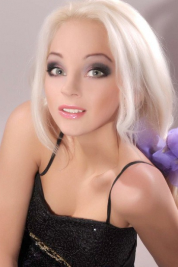 Ukrainian girl Alena,29 years old with blue eyes and blonde hair.