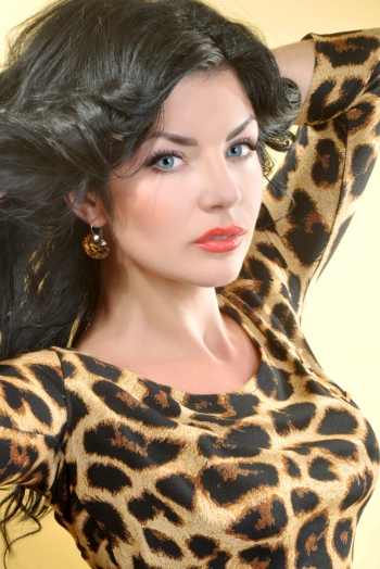 Ukrainian girl Anna,33 years old with blue eyes and black hair.
