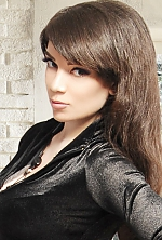 Ukrainian girl Nataliya,25 years old with blue eyes and dark brown hair.