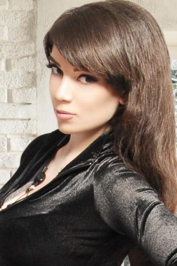 Ukrainian girl Nataliya,25 years old with blue eyes and dark brown hair.