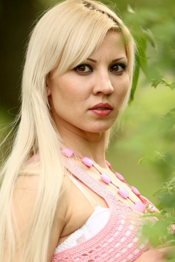 Ukrainian girl Maria,31 years old with brown eyes and blonde hair.