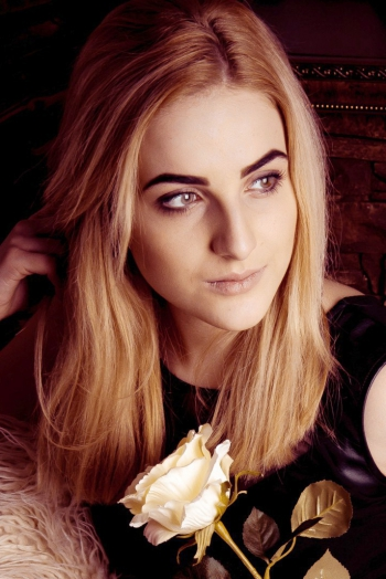 Ukrainian girl Yaroslava,19 years old with green eyes and light brown hair.