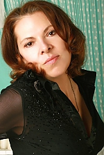 Ukrainian girl Natalya,46 years old with hazel eyes and light brown hair.