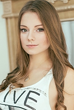 Ukrainian girl Olga,20 years old with green eyes and light brown hair.