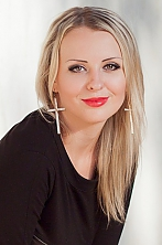 Ukrainian girl Tatyana,33 years old with green eyes and blonde hair.