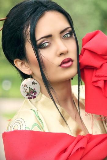 Ukrainian girl Jana,21 years old with green eyes and dark brown hair.