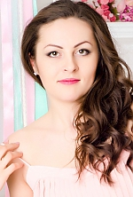 Ukrainian girl Elena,25 years old with green eyes and light brown hair.