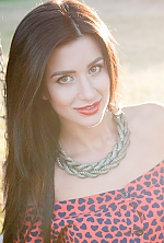 Ukrainian girl Elina,29 years old with hazel eyes and black hair.