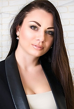 Ukrainian girl Marta,28 years old with green eyes and dark brown hair.