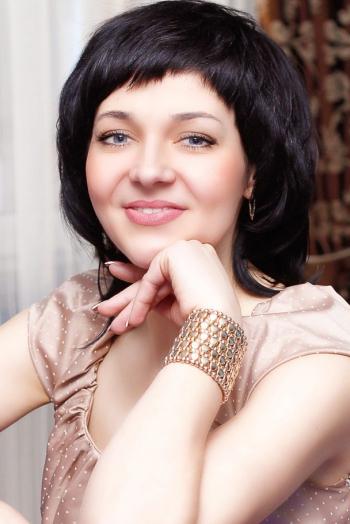 Ukrainian girl Oksana,36 years old with blue eyes and black hair.