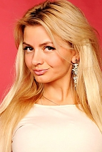 Ukrainian girl Eugenia,32 years old with brown eyes and blonde hair.