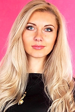 Ukrainian girl Violetta,33 years old with grey eyes and blonde hair.