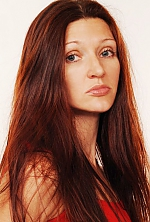 Ukrainian girl Lyudmila,41 years old with grey eyes and red hair.