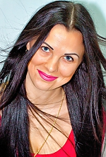 Ukrainian girl Irina,33 years old with blue eyes and black hair.
