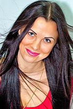 Ukrainian girl Irina,32 years old with blue eyes and black hair.