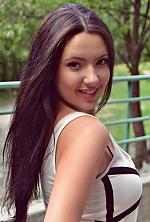Ukrainian girl Alexandra,21 years old with green eyes and dark brown hair.