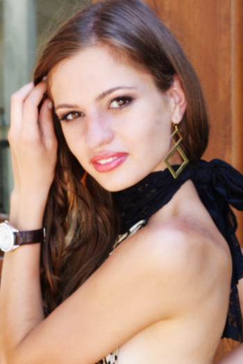 Ukrainian girl Anastasia,27 years old with hazel eyes and light brown hair.