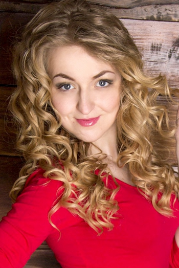 Ukrainian girl Anastasia,21 years old with blue eyes and blonde hair.