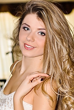 Ukrainian girl Angelina,22 years old with grey eyes and blonde hair.