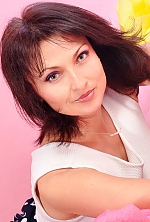 Ukrainian girl Veronika,45 years old with green eyes and dark brown hair.