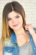 Ukrainian girl Marina,26 years old with green eyes and light brown hair.