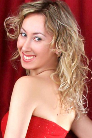 Ukrainian girl Viktoria,35 years old with grey eyes and blonde hair.