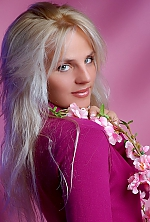 Ukrainian girl Elena,30 years old with blue eyes and blonde hair.