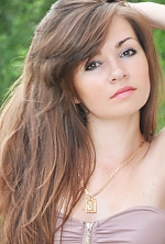 Ukrainian girl Yana,26 years old with hazel eyes and dark brown hair.