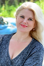 Ukrainian girl Elena,45 years old with green eyes and blonde hair.