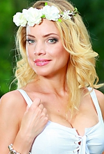 Ukrainian girl Olga,34 years old with  eyes and  hair.