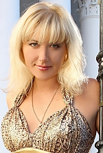 Ukrainian girl Maria,36 years old with brown eyes and blonde hair.