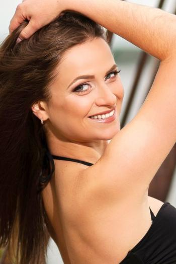 Ukrainian girl Tatyana,27 years old with blue eyes and auburn hair.