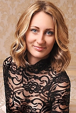 Ukrainian girl Olga,29 years old with blue eyes and light brown hair.