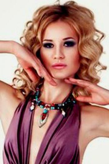 Ukrainian girl Yana,20 years old with brown eyes and blonde hair.