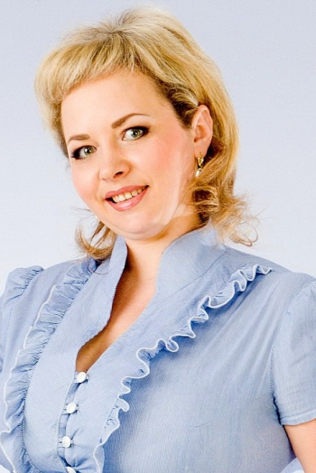 Ukrainian girl Natalia,35 years old with green eyes and blonde hair.