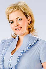 Ukrainian girl Natalia,34 years old with green eyes and blonde hair.