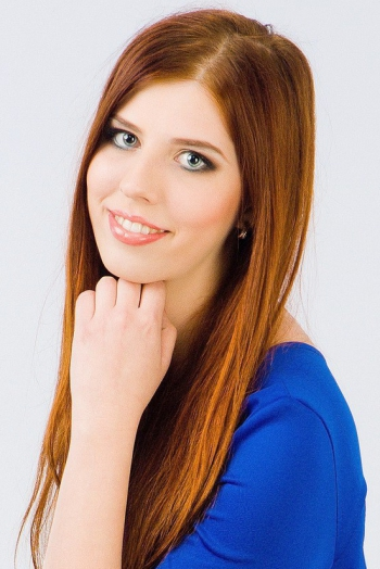 Ukrainian girl Alla,24 years old with blue eyes and light brown hair.