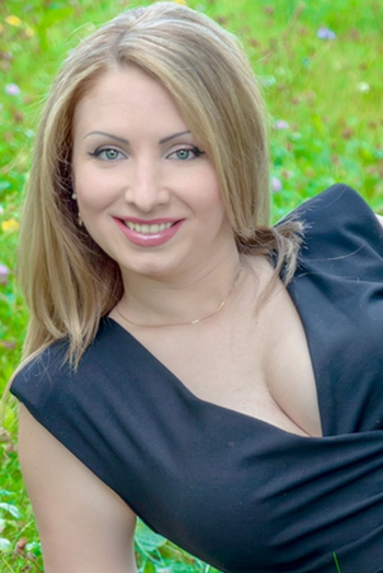 Ukrainian girl Ilona,33 years old with green eyes and blonde hair.