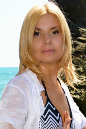 Ukrainian girl Tatiana,50 years old with brown eyes and blonde hair.