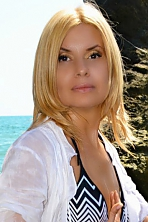 Ukrainian girl Tatiana,50 years old with brown eyes and blonde hair.