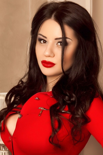 Ukrainian girl Tamila,21 years old with hazel eyes and black hair.