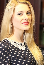 Ukrainian girl Tatyana,26 years old with grey eyes and blonde hair.