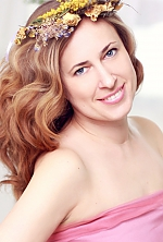 Ukrainian girl Tatyana,39 years old with blue eyes and light brown hair.