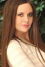 Ukrainian girl Olesya,32 years old with brown eyes and dark brown hair.