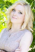 Ukrainian girl Anastasia,22 years old with green eyes and blonde hair.