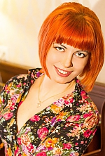 Ukrainian girl Elena,32 years old with green eyes and red hair.