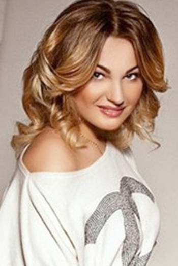 Ukrainian girl Daria,27 years old with grey eyes and light brown hair.