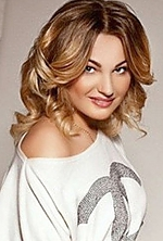 Ukrainian girl Daria,27 years old with grey eyes and light brown hair.