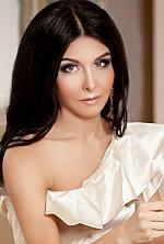 Ukrainian girl Dasha,28 years old with blue eyes and black hair.
