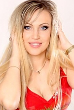Ukrainian girl Mariana,38 years old with blue eyes and blonde hair.